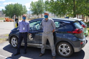 John Gitchell and Seth Bossung in front of an Eagle County EV